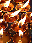 Butter lamps are lit as offerings in Bhuddist temples and represent the illumination of wisdom.