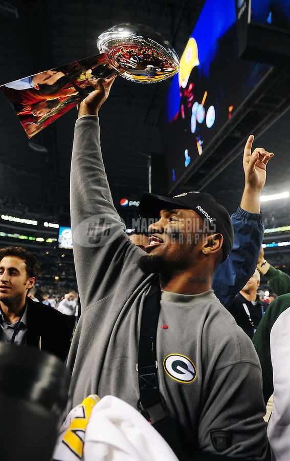 Feb 6, 2011; Arlington, TX, USA; Green Bay Packers cornerback Charles Woodson celebrates with the Vince Lombardi Trophy following Super Bowl XLV against the Pittsburgh Steelers at Cowboys Stadium. The Packers defeated the Steelers 31-25. Mandatory Credit: Mark J. Rebilas-
