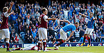 Lee McCulloch runs to celebrate his first goal after first looking over to the linesman