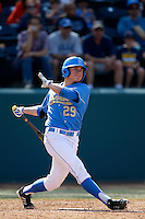Ty Moore #29 of the UCLA Bruins bats against the California Golden Bears at Jackie Robinson Stadium on March 23, 2013 in Los Angeles, California. (Larry Goren/Four Seam Images)