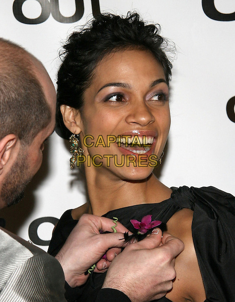 ROSARIO DAWSON.The 11th annual OUT100 Awards Celebration at Capitale, New York, NY..November 11th, 2005.Photo: Jackson Lee/Admedia/Capital Pictures.Ref: JL/ADM.headshot portrait dangling earrings smiling laughing flower corsage.www.capitalpictures.com.sales@capitalpictures.com.© Capital Pictures.