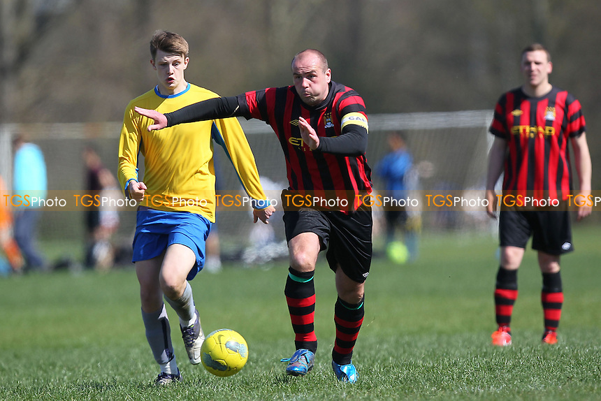 Chapel N1 (black/red) vs Jay Cubed - Hackney & Leyton Sunday League Jack Morgan Cup Semi-Final Football at South Marsh, Hackney Marshes, London - 21/04/13 - MANDATORY CREDIT: Gavin Ellis/TGSPHOTO - Self billing applies where appropriate - 0845 094 6026 - contact@tgsphoto.co.uk - NO UNPAID USE.