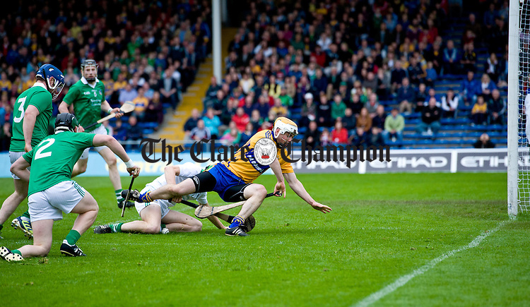 XXX of Clare in action against Nickie Quaid of Limerick during their game at Semple Stadium. Photograph by John Kelly.