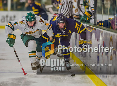 21 February 2015:  University of Vermont Catamount Defenseman Trey Phillips, a Freshman from Okotoks, Alberta, races for the puck against Merrimack College Warrior Defenseman/Forward Justin Mansfield, a Senior from Arlington, MA, in the third period at Gutterson Fieldhouse in Burlington, Vermont. The teams played to a scoreless tie as the Cats wrapped up their Hockey East regular home season. Mandatory Credit: Ed Wolfstein Photo *** RAW (NEF) Image File Available ***