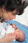 3 day old newborn baby boy looking at mother's face