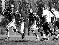 Oscar Kruger and Bill Smith Edmonton Eskimos 1963 in a game against the Ottawa Rough Riders. Photo copyright Scott Grant