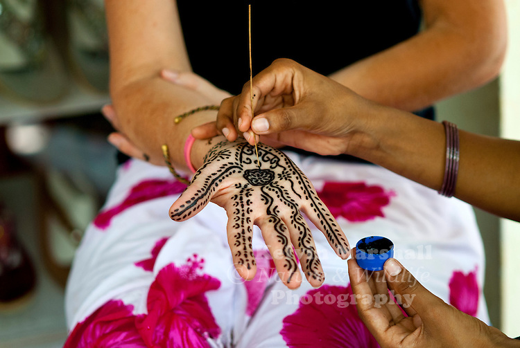In India, women can often be seen with intricately decorated hands and feet. Find out more about the tradition behind henna tattoos and the art of mehndi designs...