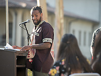 Occidental College faculty member Kenjus Watson '07, Education Dept.<br /> Black Graduation Celebration at Academic Quad, May 20, 2017.<br /> Cultural Graduation Celebrations are an opportunity for smaller groups to come together and acknowledge students' accomplishments with family and friends while celebrating the rich diversity of our campus. The Office of Intercultural Affairs partners with cultural organizations to coordinate the events.<br /> (Photo by Marc Campos, Occidental College Photographer)