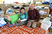May 18, 2011; Minamisanriku, Miyagi Pref., Japan - Kuniko (L) and Toyotaro Suzuki sit in their living area at the Shizukawa High School Evacuation Center in Minamisanriku. ..There home was completely destroyed but all their family members survived the March 11, 2011 Great Tohoku Earthquake and Tsunami that devastated the Northeast coast of Japan.