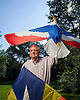 Dave Herzig, who leads kite-making workshops for kids, in the backyard of his Minnetonka, Minnesota home. Photo by Kevin J. Miyazaki/Redux