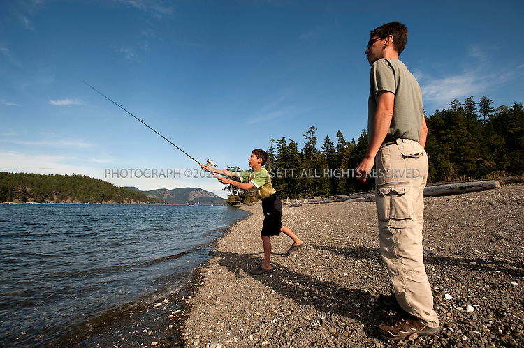 8/25/2009--Pender Island, British Columbia, Canada..A family (no names given) fishing on the Mortimer Spit on   South Pender Island...©2009 Stuart Isett. All rights reserved.