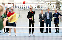 31 October 2017 - Princess Kate, Duchess of Cambridge takes part in a Tennis for Kids session with the President of the LTA, Martin Corrie (R), and LTA Director of Human Resources Vicky Williams during a visit at the Lawn Tennis Association (LTA) at the National Tennis Centre in southwest London. Duchess of Cambridge visited the LTA, the national governing body of tennis, where she was briefed on the organisations latest activities and objectives, and had the opportunity to watch a number of tennis demonstrations at the National Tennis Centre's on-court facilities. Photo Credit: ALPR/AdMedia
