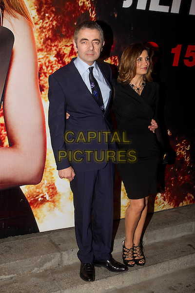 "Rowan Atkinson & Sunetra Sastry  .At the Premiere of ""Real Steel"", Moscow, Russia, 8th September 2011..full length navy blue suit white shirt couple wife husband couple married black  shoes dress .CAP/PER/SB.©SB/PersonaStars/Capital Pictures."