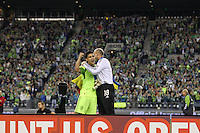 Kasey Keller (18 ) of the Seattle Sounders FC celebrates with teammate Fredy Montero (17). The Seattle Sounders FC defeated the Columbus Crew 2-1 during the US Open Cup Final at Qwest Field in Seattle,WA, on October 5, 2010.
