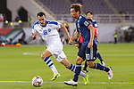 Muto Yoshinori of Japan (R) competes for the ball with Fozil Musaev of Uzbekistan (L) during the AFC Asian Cup UAE 2019 Group F match between Japan (JPN) and Uzbekistan (UZB) at Khalifa Bin Zayed Stadium on 17 January 2019 in Al Ain, United Arab Emirates. Photo by Marcio Rodrigo Machado / Power Sport Images