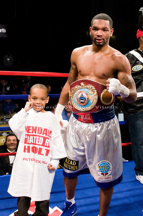 Atlantic City, N.J, 12.13.2008: Kendall Holt (white trunks) and his son in the ring after his 12 rounds  WBO Jr. Lightweight Championship fight against Demetrius Hopkins at the Boardwalk Hall. Holt retained his belt with a split decision.