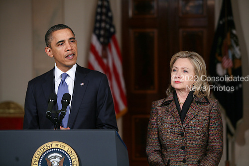 United States President Barack Obama gave brief remarks in the Grand Foyer of the White House in Washington, D.C. concerning the deteriorating situation in the country of Libya between forces loyal to Muammar el-Qaddafi and protesters trying to oust him on February 23, 2011 . Standing next to the president was U.S. Secretary of State Hillary Rodham Clinton. .Credit: Gary Fabiano / Pool via CNP