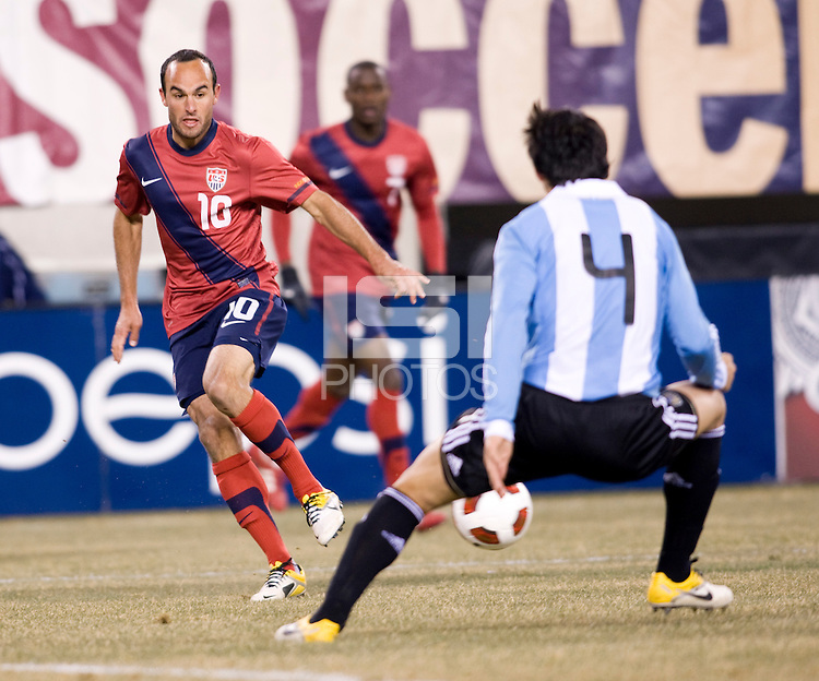 Landon Donovan, Nicolas Burdisso. The USMNT tied Argentina, 1-1, at the New Meadowlands Stadium in East Rutherford, NJ.