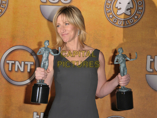 EDIE FALCO.At The 14th Annual Screen Actors Guild Award held at The Shrine Auditorium in Los Angeles, California USA, January 27 2008. .SAG Pressroom press room half length green grey gray dress two awards.CAP/DVS.©Debbie VanStory/Capital Pictures