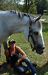 WEST HILLS,NY-MONDAY, SEPTEMBER 3, 2007: Gregg and Susan Lopez of Huntington with &quot;Titania&quot; a Thoroughbred horse with whom Gregg Lopez has bonded in Equine Therapy at the Stanhope Stables in West Hills on Monday September 3, 2007. Lopez suffers from a variety of ailments both physical and mental from the months he worked in recovery efforts at the World Trade Center Ground Zero.<br /> Newsday / Jim Peppler
