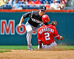 10 July 2011: Colorado Rockies All-Star shortstop Troy Tulowitzki gets a sliding Roger Bernadina out stealing during a game against the Washington Nationals at Nationals Park in Washington, District of Columbia. The Nationals shut out the visiting Rockies 2-0 salvaging the last game their 3-game series at home prior to the All-Star break. Mandatory Credit: Ed Wolfstein Photo