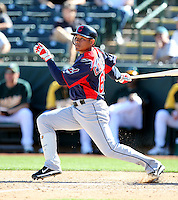 Ezequiel Carrera #65 of the Cleveland Indians bats against the Oakland Athletics in a spring training game at Phoenix Municipal Stadium on March 2, 2011  in Phoenix, Arizona. .Photo by:  Bill Mitchell/Four Seam Images.
