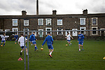 Home team players go through their pre-match warm-up before Nelson hosted Daisy Hill in a North West Counties League first division north fixture at Victoria Park. Founded in 1881, the home club were members of the Football League from 1921-31 and has played at their current ground, known as Little Wembley, since 1971. The visitors won this fixture 6-3, watched by an attendance of 78.