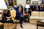 US President Donald J. Trump (C) delivers remarks during a meeting with President of Italy Sergio Mattarella (L), as US Secretary of State Mike Pompeo (Back C) looks on; in the Oval Office of the White House in Washington, DC, USA, 16 October 2019. The leaders meet to discuss a wide variety of economic and security issues such as telecommunications security, the NATO alliance and the Turkish incursion into Syria.<br /> Credit: Michael Reynolds / CNP