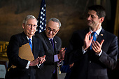 Senate Majority Leader Mitch McConnell, a Republican from Kentucky, Senate Minority Leader Chuck Schumer, a Democrat from New York, and U.S. House Speaker Paul Ryan, a Republican from Wisconsin, applaud during a congressional Gold Medal ceremony for former Senator Bob Dole, in Washington D.C., U.S., on Wednesday, Jan. 17, 2018. Photographer: Al Drago/Bloomberg<br /> Credit: Al Drago / Pool via CNP