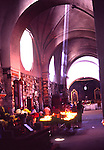 Shaft of light inside church shines on candles, Antigua, Guatemala, Central America,