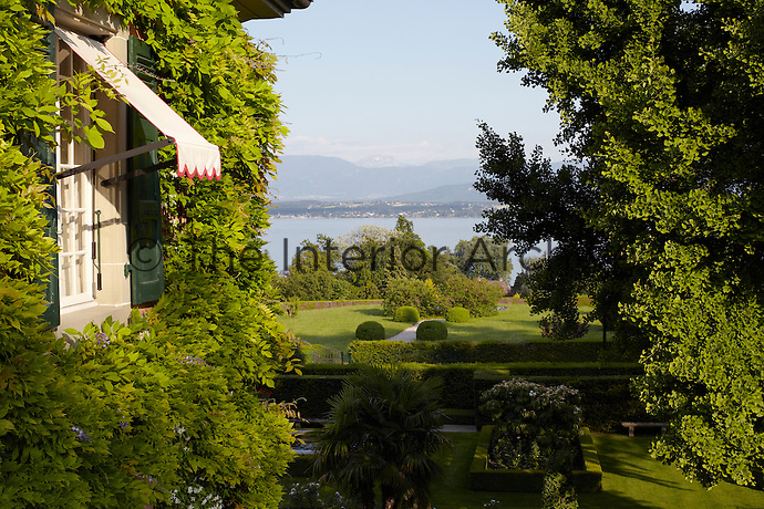The villa has views over Lake Geneva to the mountains beyond
