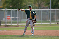 Oakland Athletics third baseman Javier Godard (6) throws to first base during a Minor League Spring Training game against the Chicago Cubs at Sloan Park on March 13, 2018 in Mesa, Arizona. (Zachary Lucy/Four Seam Images)