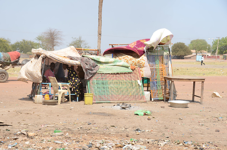 South Sudanese returnees seek temporary refuge in a primary school in Bentiu, Unity state, on their way back to their tribal lands. They had travelled for days, across the border from north Sudan, ahead of the separation of north and south Sudan on 9 July 2011. Due to heavy rains and local fighting, they had already waited for more than three weeks for onward transport to Mayom county. When I met them, food supplies provided by the World Food Programme had run out. The next day, WFP aid workers were attacked by returnees desperate for food. Just a few yards away within sight of the school was a WFP food depot with grain for delivery to the returnees' destination, but in an effort to encourage the flow of returnees, WFP policy dictated that food supplies were initially provided for only a few days.
