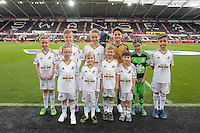 Children mascots before the Barclays Premier League match between Swansea City and Arsenal at the Liberty Stadium, Swansea on October 31st 2015