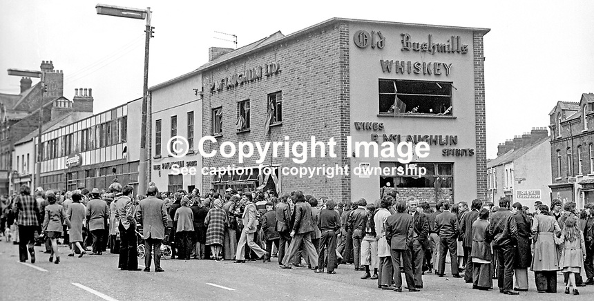 Hundreds of people outside McLaughlin's Bar, Antrim Road, Belfast, N Ireland, following an explosion in which 2 died and 15 were injured. The gas cylinder bomb was planted by the UVF. The incident occured whilst the bar was packed with customers watching the Grand National.  Later the same day a retaliation bombing took place at the Mountainview Tavern on the Loyalist Shankill Road in which 5 Protestants died. 5th April 1975. 197504050355c<br /> <br /> Copyright Image from Victor Patterson, 54 Dorchester Park, Belfast, United Kingdom, UK.  Tel: +44 28 90661296; Mobile: +44 7802 353836; Voicemail: +44 20 88167153;  Email1: victorpatterson@me.com; Email2: victor@victorpatterson.com<br /> <br /> For my Terms and Conditions of Use go to http://www.victorpatterson.com/Terms_%26_Conditions.html