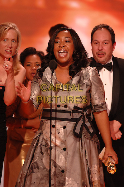 "SHONDA RHIMES.""Grey's Anatomy"" accepting the award for Best Dramatic Series.Telecast - 64th Annual Golden Globe Awards, Beverly Hills HIlton, Beverly Hills, California, USA..January 15th 2007. .globes half length stage microphone trophy grey gray dress.CAP/AW.Please use accompanying story.Supplied by Capital Pictures.© HFPA"" and ""64th Golden Globe Awards"""