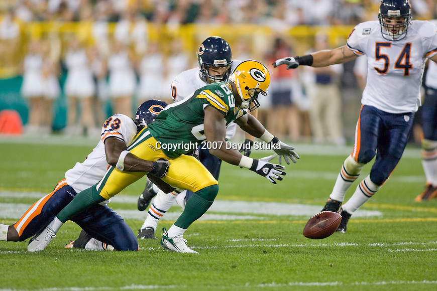 Defensive back Danieal Manning #38 of the Chicago Bears forces wide recevier James Jones #89  of the Green Bay Packers to fumble at Lambeau Field on October 7, 2007 in Green Bay, Wisconsin. The Bears beat the Packers 27-20. (Photo by David Stluka)