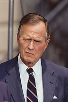 ***FILE PHOTO*** George H.W. Bush Has Passed Away<br /> Washington, DC. 1991<br /> President George H.W. Bush ponders  a question from a reporter outside the South entrance to the White House.<br /> CAP/MPI/MRN<br /> &copy;MRN/MPI/Capital Pictures