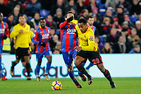 Andre Carrillo of Watford holds off Yohan Cabaye of Crystal Palace during the EPL - Premier League match between Crystal Palace and Watford at Selhurst Park, London, England on 12 December 2017. Photo by Carlton Myrie / PRiME Media Images.