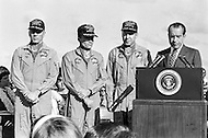 18 Apr 1970, Honolulu, Oahu, Hawaii, USA --- President Nixon welcomes back the crew of the ill-fated Apollo 13 mission in a special ceremony. Fred Haise, Mission Commander James Lovell, and John Swigert were forced to abort their moon landing after the command module experienced a major malfunction. --- Image by © JP Laffont
