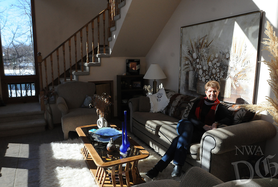 NWA Democrat-Gazette/FLIP PUTTHOFF <br /> LET THE SUNSHINE IN<br /> Kathy Trotter enjoys the lake life    Wednesday Feb. 18 2015    at her home on Beaver Lake east of Lowell.