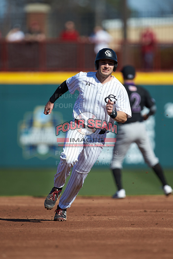 Brennan Milone (7) of the South Carolina Gamecocks hustles towards third base against the Holy Cross Crusaders at Founders Park on February 15, 2020 in Columbia, South Carolina. The Gamecocks defeated the Crusaders 9-4.  (Brian Westerholt/Four Seam Images)