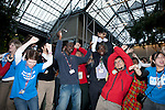 Members of the International Youth Climate Movement preform a dance in front of the plenary, calling for strong action and climate justice. (©Robert van Waarden)