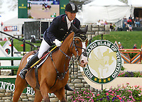 Bruce 'Buck' Davidson Jr. and #58 Ballynoe Castle RM from the USA at the Rolex Three Day Event.   April 28, 2013..