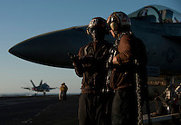 120307-N-DR144-275 ARABIAN GULF (March 7, 2012) Aviation Ordnanceman 3rd Class Akeen Malone, left, and another Sailor assigned to Strike Fighter Squadron (VFA) 81's line shack wait to chain down aircraft on the flight deck aboard the Nimitz-class aircraft carrier USS Carl Vinson (CVN 70). Carl Vinson and Carrier Air Wing (CVW) 17 are deployed to the U.S. 5th Fleet area of responsibility.  (U.S. Navy photo by Mass Communication Specialist 2nd Class James R. Evans/Released)