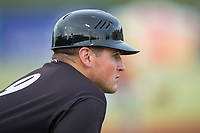 Kannapolis Intimidators manager Justin Jirschele (9) coaches third base during the game against the Greensboro Grasshoppers at Kannapolis Intimidators Stadium on August 13, 2017 in Kannapolis, North Carolina.  The Grasshoppers defeated the Intimidators 3-0.  (Brian Westerholt/Four Seam Images)