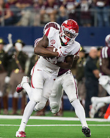 Hawgs Illustrated/Ben Goff<br /> Mike Woods, Arkansas wide receiver, breaks the tackle of  Charles Oliver, Texas A&M cornerback, for a 29-yard touchdown in the 4th quarter Saturday, Sept. 29, 2018, during the Southwest Classic at AT&T Stadium in Arlington, Texas.