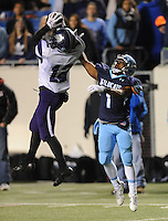 NWA Democrat-Gazette/ANDY SHUPE<br /> Joey Savin (12) of Fayetteville makes his third interception of the game over Trey Smith of Har-Ber Saturday, Dec. 5, 2015, during the first half of the Class 7A state championship game at War Memorial Stadium in Little Rock. Visit nwadg.com/photos to see more photographs from the game.