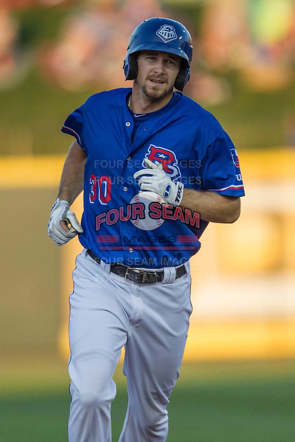 Round Rock Express outfielder Jared Hoying (30) jogs around the bases after hitting a first inning home run during the Pacific Coast League baseball game against the Omaha Storm Chasers on June 1, 2014 at the Dell Diamond in Round Rock, Texas. The Express defeated the Storm Chasers 11-4. (Andrew Woolley/Four Seam Images)