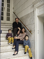 Anne-Marie Midy and Jorge Almada with their sons Antoine and Olivier on the entrance steps to their home